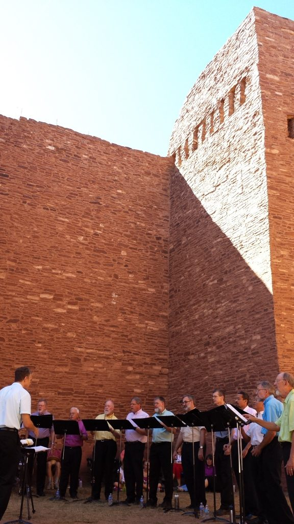 De Profundis, an a capella men's choir, at their annual performance at Quarai Ruins. The performance was hosted by the Manzano Mountain Arts Council and the Salinas Pueblo Missions National Monument, and saw nearly 300 people attend the event, according to organizers. Photo by Leota Harriman.