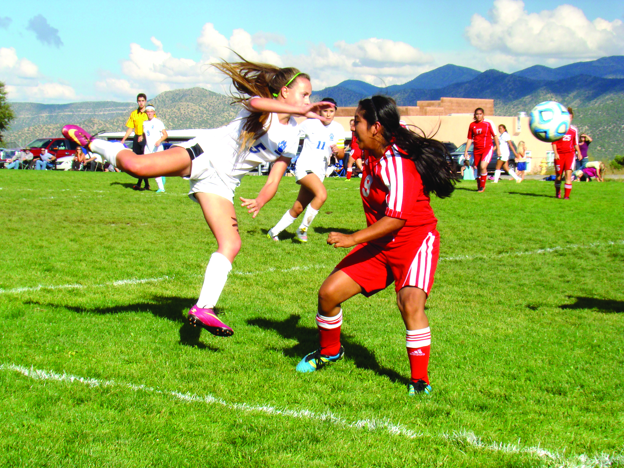 East Mountain's Mia Santistevan putting her whole body into a shot in Tuesday's victory over Bernalillo. For story and more sports, see page 11. Photo by G. Demarest.