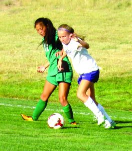 Manzano's Aubry Hershberger and Moriarty's Elizabeth Robinson battling for the ball. Photo by G. Demarest.