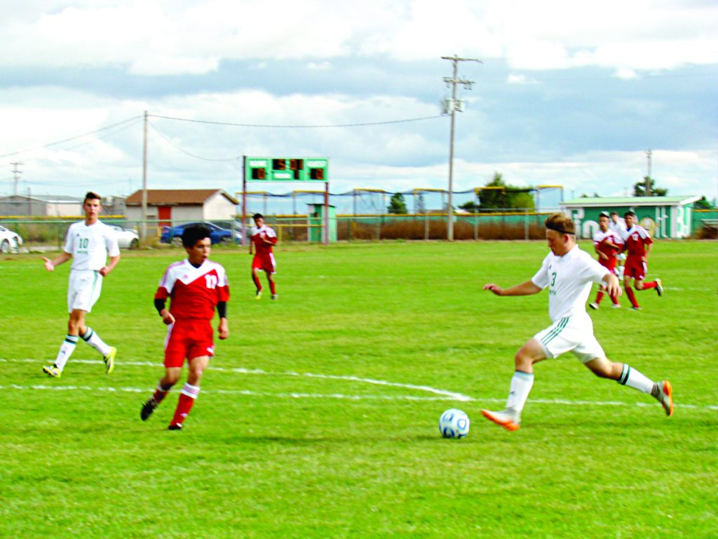 Ayden Greene shooting Moriarty's first goal during last Thursday's game against Grants. Photo by G. Demarest.