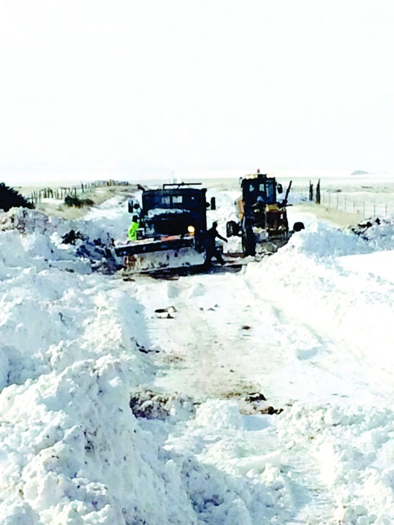 Torrance County road crews were out starting at 3 a.m. the night of the first storm. Photo by Joy Ansley.