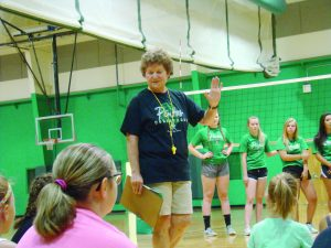 Moriarty Coach Kim Bell explaining volleyball fundamentals to young players. Photo by G. Demarest.