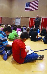 The right to peaceably assemble: 5th-grade students at Route 66 Elementary School studying the U.S. Constitution with Magistrate Judge Matt Page. Photo by Leota Harriman.