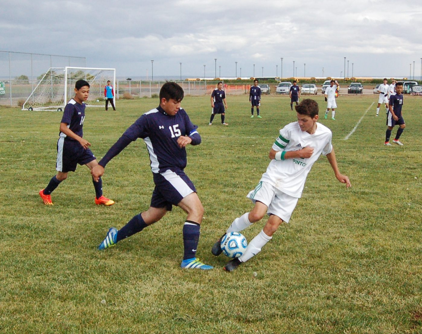 Moriarty's Wyatt Jones trying to win the ball from a Ruidoso defender. Photo by G. Demarest.