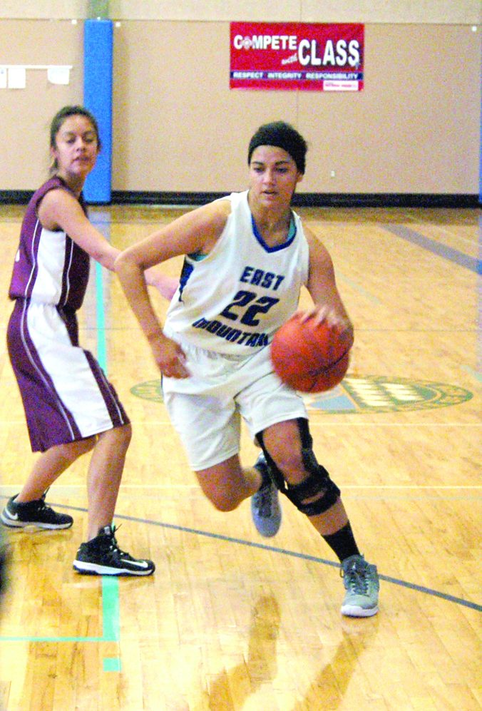 East Mountain's Espie Sanchez-Apodaca driving past a defender in Saturday's win over ATC. Photo by G. Demarest.