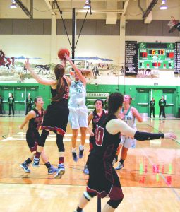 Moriarty's Alyssa Adams launching a jump shot during last Friday's game against Portales. Photo by G. Demarest.
