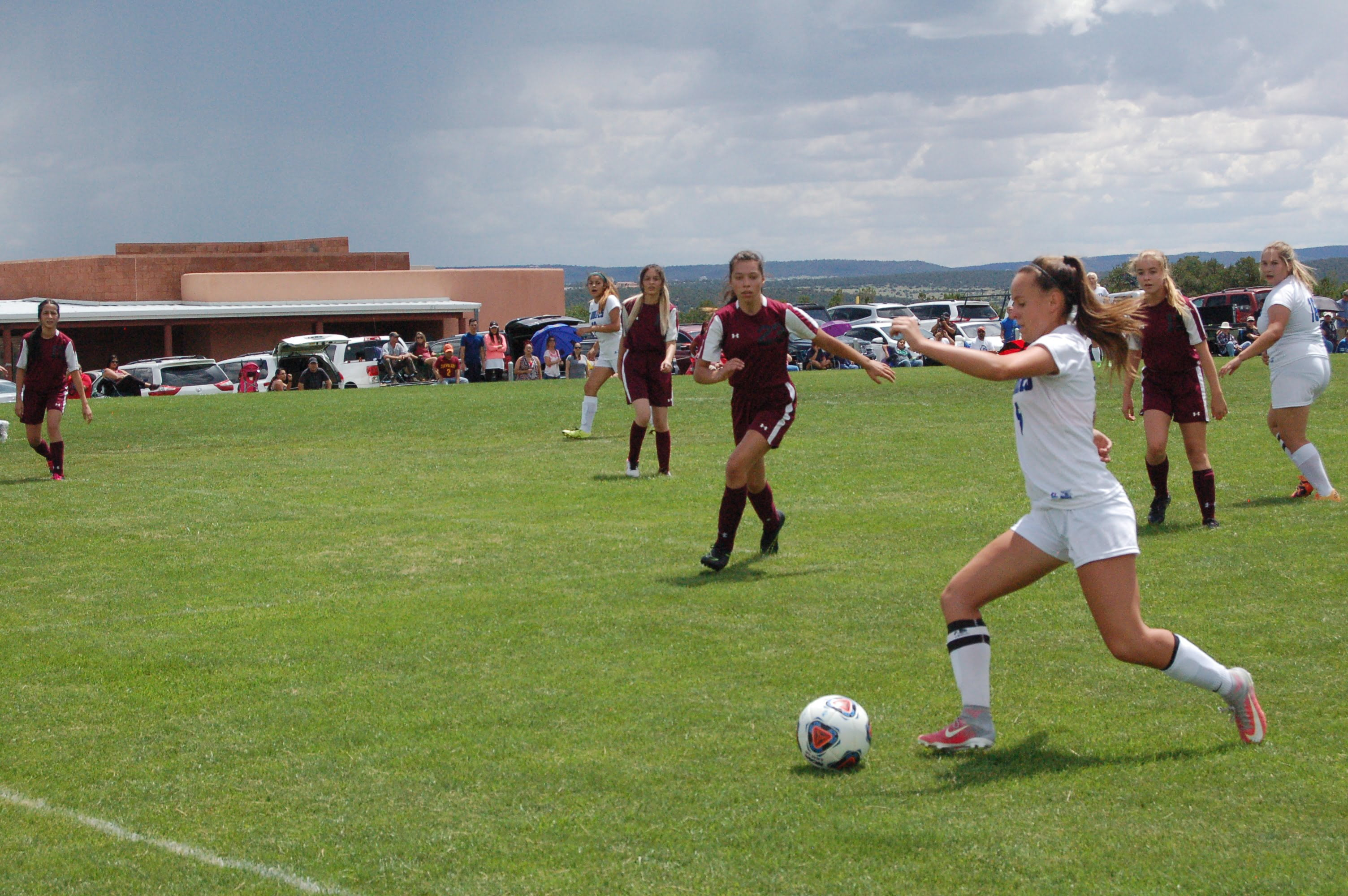EMHS girls brave severe weather, beat ATC for first victory of season