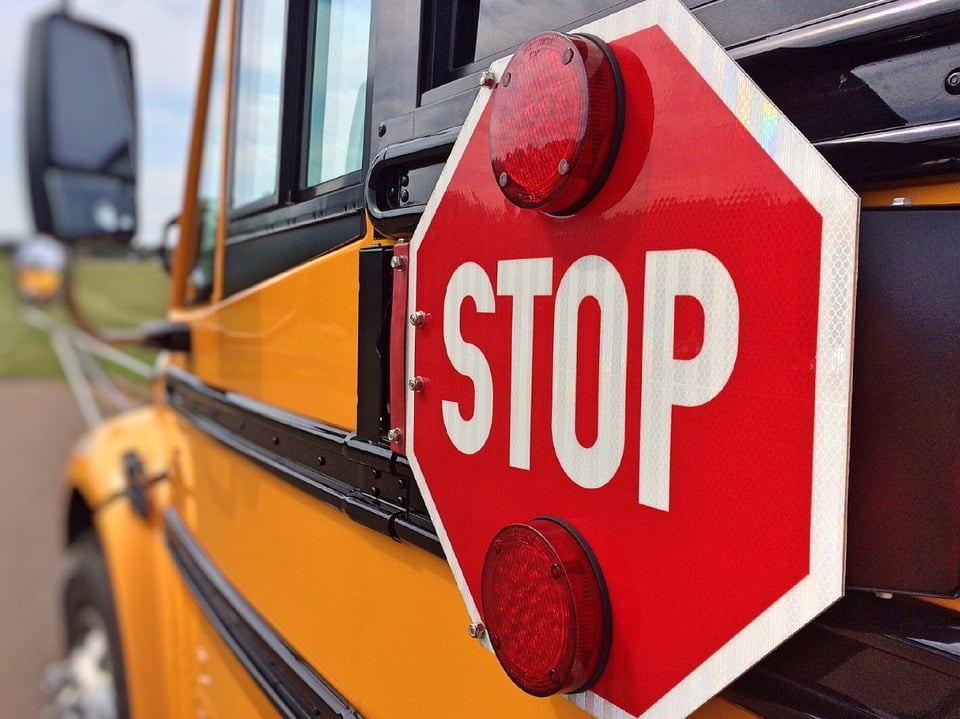 Drivers passing school buses with flashing lights