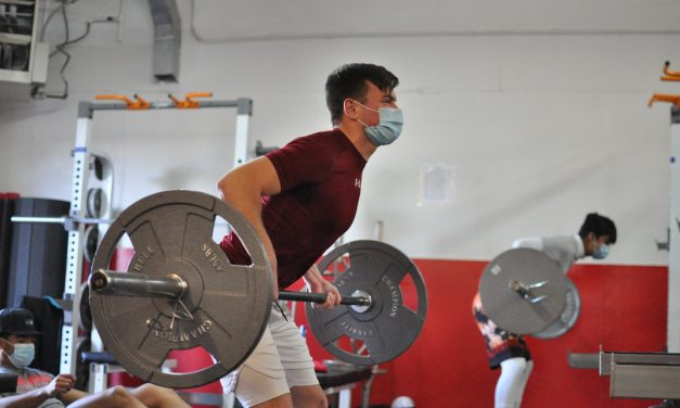 High school athletes back in the weight room and hoping for sports to return